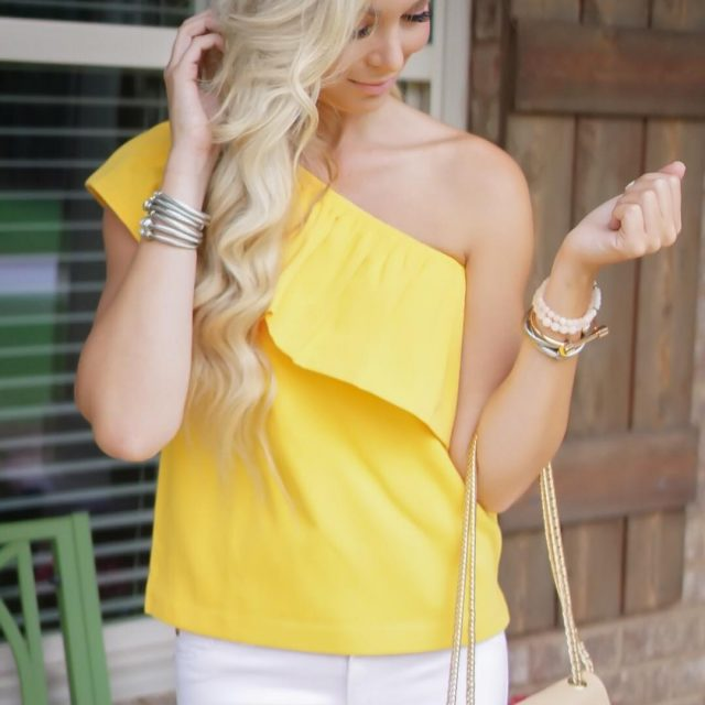 This cheery yellow oneshoulder top is good as gold! hellip